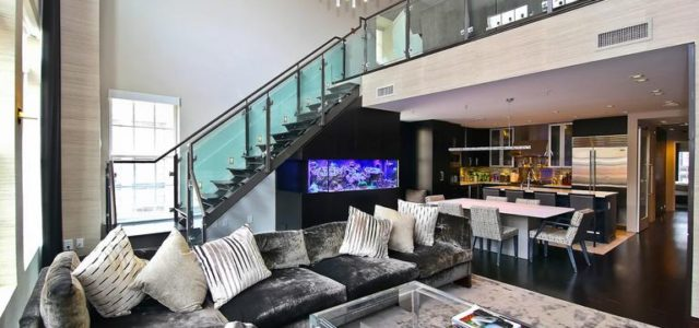 A custom fish tank, an illuminated bar, and TVs built into the bathroom mirrors are only the start of a long list of sleek upgrades made at this condo in […]